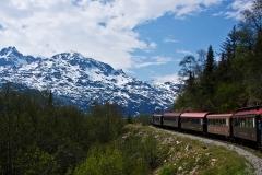 Trains running through the scenery of Skagway, Alaska