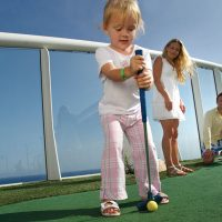 Children playing golf on a cruise ship
