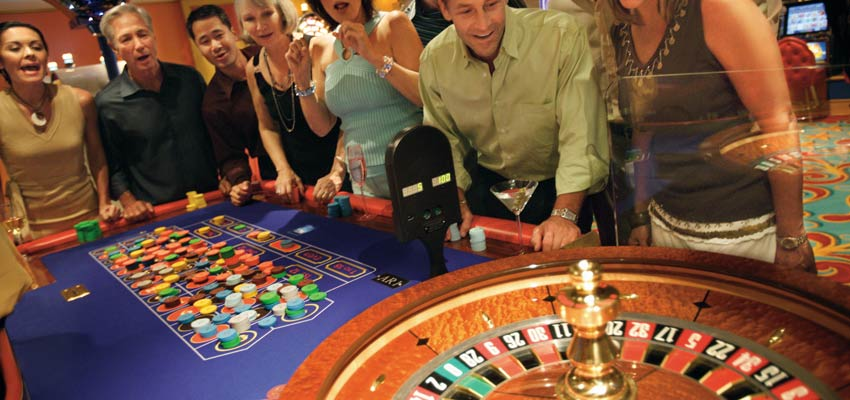 Guests playing roulette at Norwegian Cruise Line's Casino at Sea