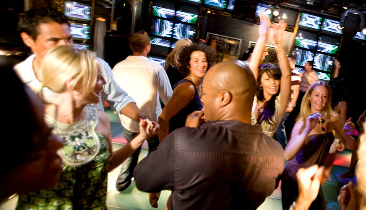Guests in casual dress code dancing in a Carnival night club