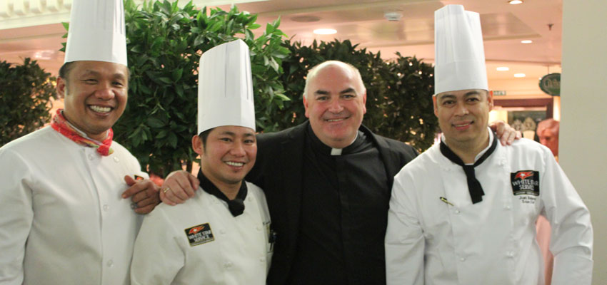 Father David Gamble with members of the crew