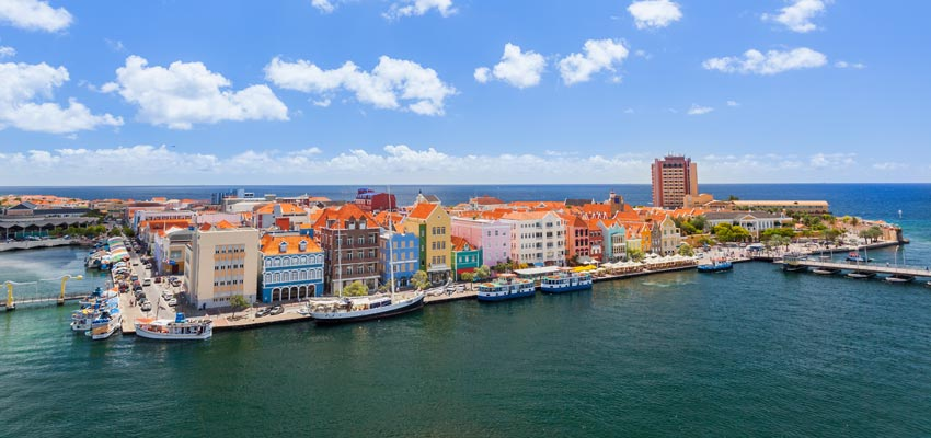 Colourful buildings on the coast of Curacao in the blissful Caribbean