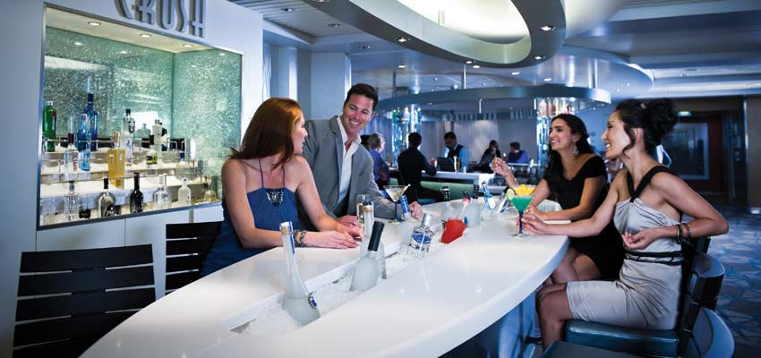 Guests enjoying drinks at Celebrity Cruises' Crush Bar