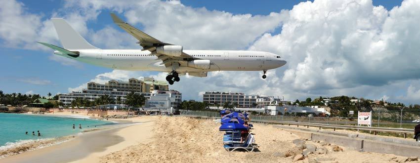 Watch out for low flying planes coming in to land over a St Maarten beach
