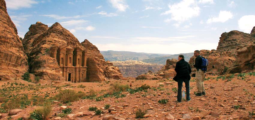 Travellers exploring the ancient city of Petra