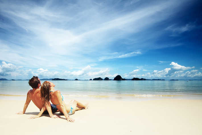 Couple sitting together on a Caribbean beach