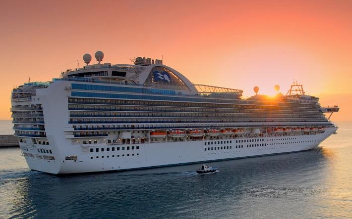 Emerald Princess cruise ship sailing away from port