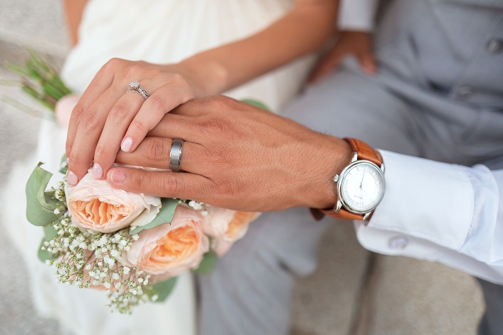 Couple holding hands after wedding cruise
