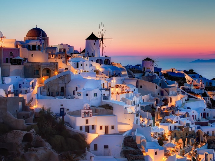 Santorini cruise port illuminated at sunset
