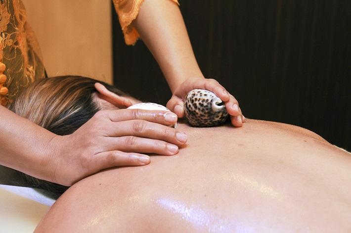 Woman enjoying a Balinese massage on MSC Meraviglia