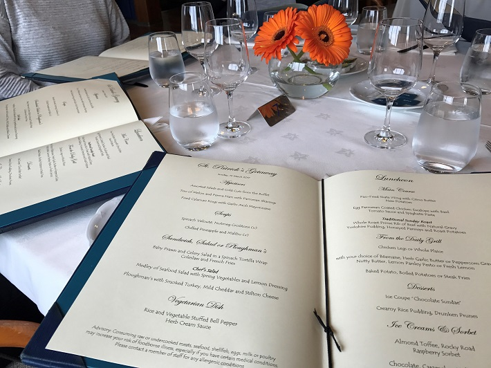 Diners seated with menus on-board Saga Pearl cruise ship