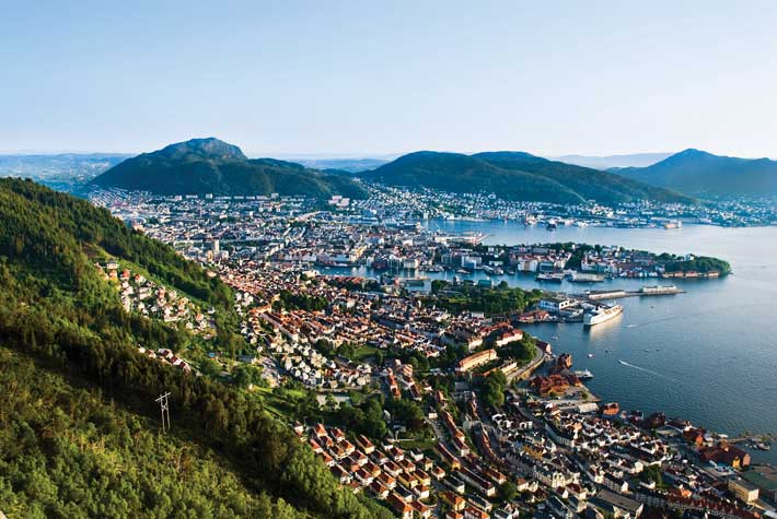 City houses nestled into the mountains in Bergen, a Norway cruise port