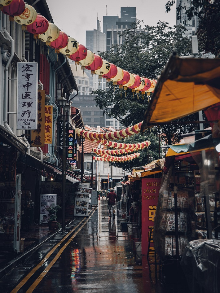 Shops and Chinese lanterns lining the path in Chinatown in Singapore