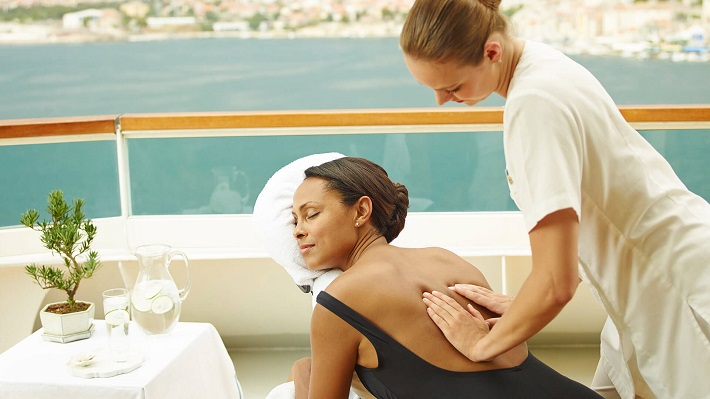 Woman enjoying an outdoor massage in the spa of her cruise ship