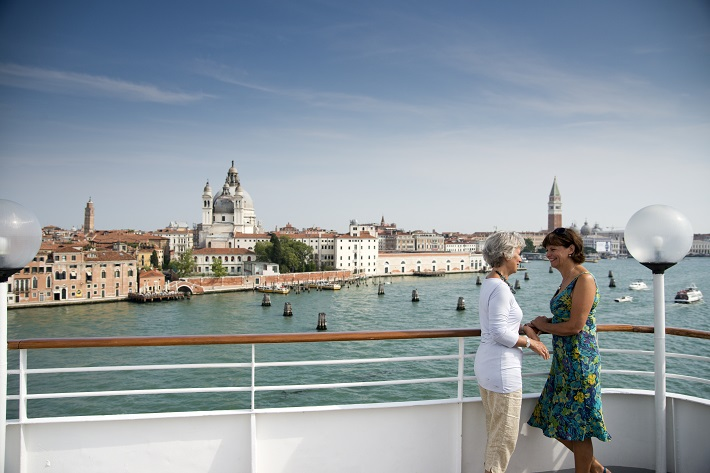 Friends admiring the view from their Fred. Olsen cruise ship in Venice