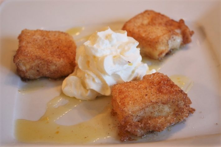 Spanish leche frita with ice cream and syrup