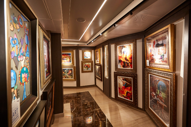 Paintings on the walls of the art gallery on-board Majestic Princess