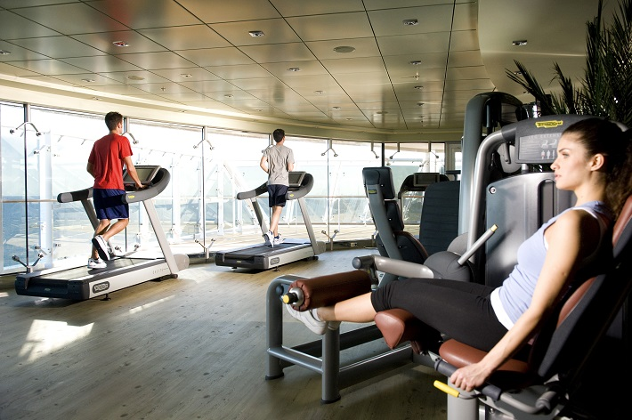 Passengers using the ocean-view gym on-board MSC Fantasia