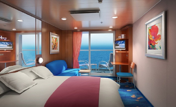 A cosy Ocean View stateroom on-board a Norwegian Cruise Line ship