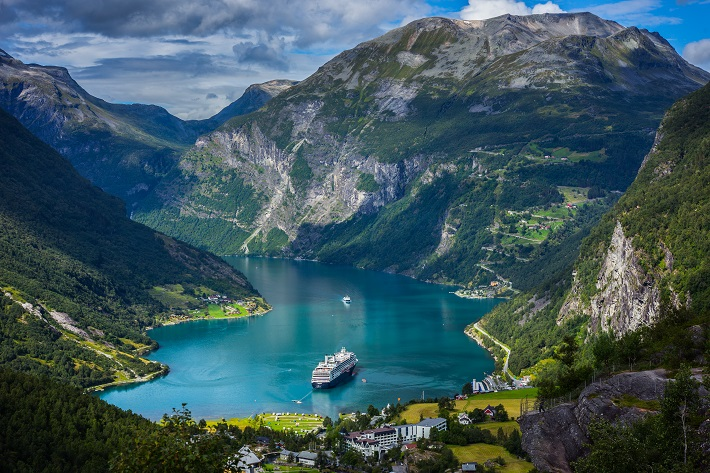 Cruise ship docked in the middle of a Norwegian fjord