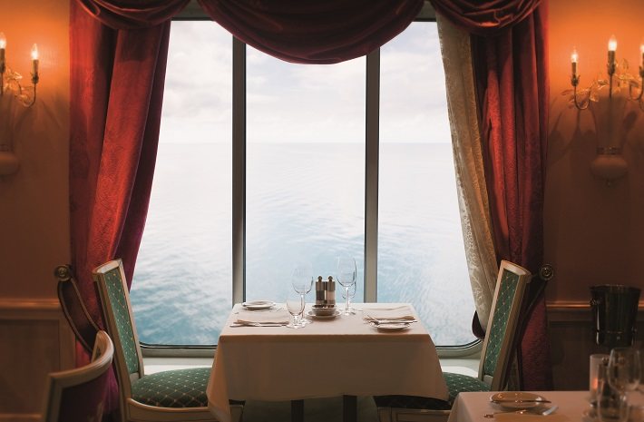 Sea-view table in the Summer Palace restaurant on-board Norwegian Pearl