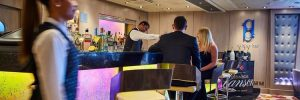Staff and guests in the Blue Bar on-board a P&O Cruises ship