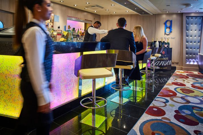 Staff and cruise ship guests in P&O Cruises' Blue Bar