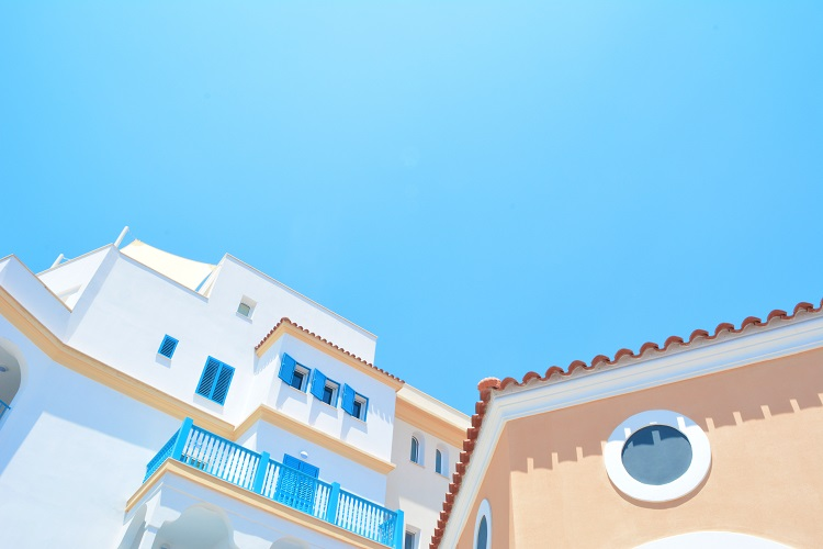 Pastel-coloured apartment buildings in Cyprus in the Eastern Med