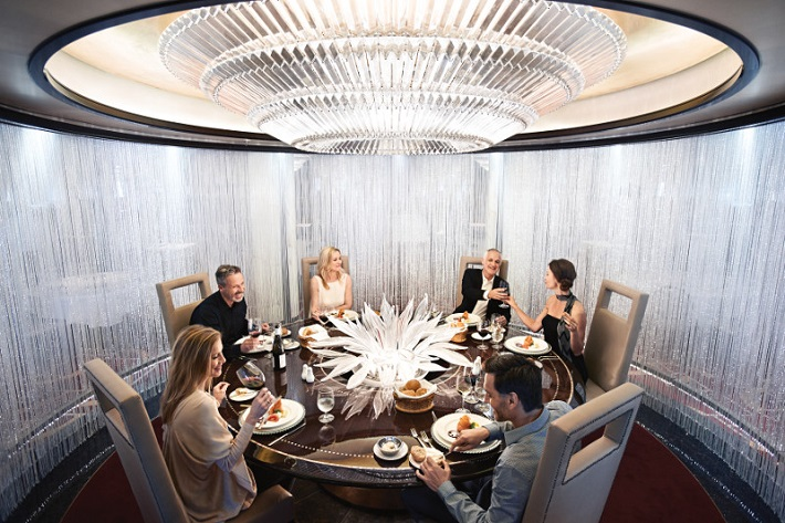 Well-dressed friends enjoying speciality dining at Chef's Table on-board Princess Cruises