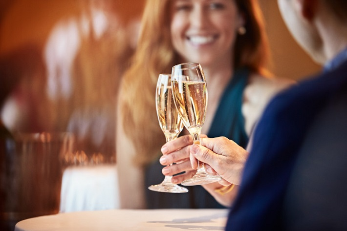 Couple toasting champagne glasses on a Princess Cruises ship