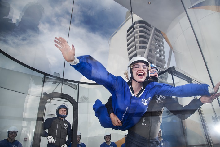 Lady enjoying the iFly skydiving simulator on-board a Royal Caribbean cruise ship