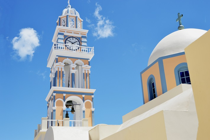 Old pastel-coloured church building in Santorini cruise port