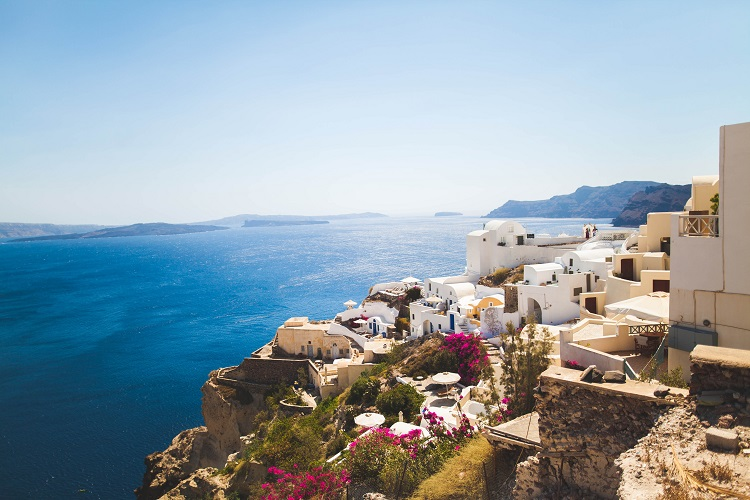 Picturesque clifftop houses and flowers in Santorini cruise port