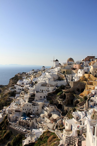 Houses and ancient buildings on a clifftop in Santorini cruise port