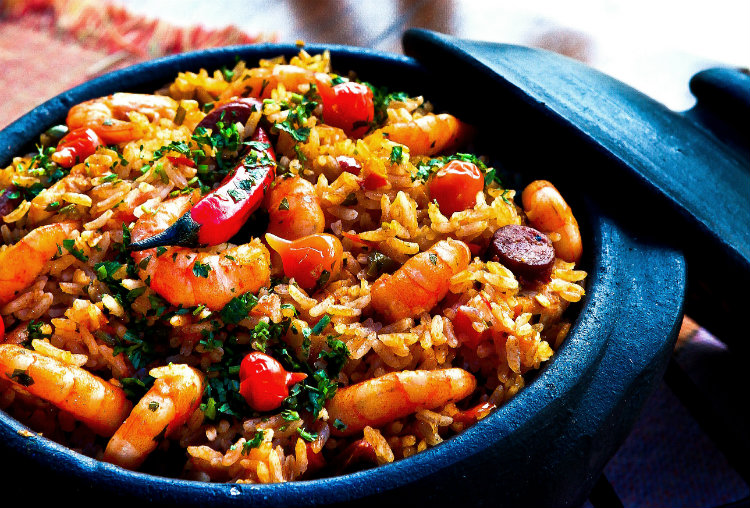 A stone dish full of seafood paella in Spain