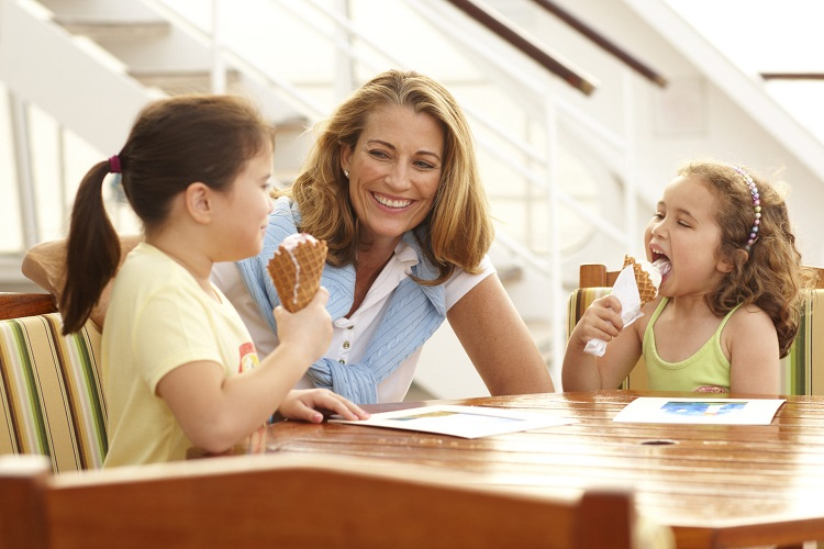 A mother and her two daughters enjoying ice cones on a Crystal Cruises ship
