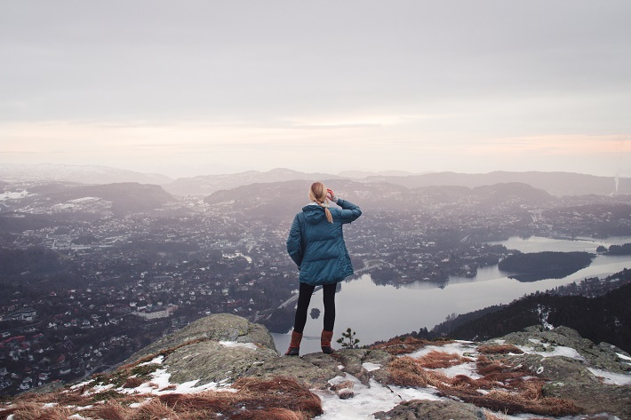 Woman admiring the view from the top of Lovstakken Mountain in Bergen