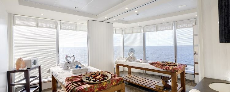 Massage beds topped with bowls of flower petals in the Aurea spa on MSC Armonia