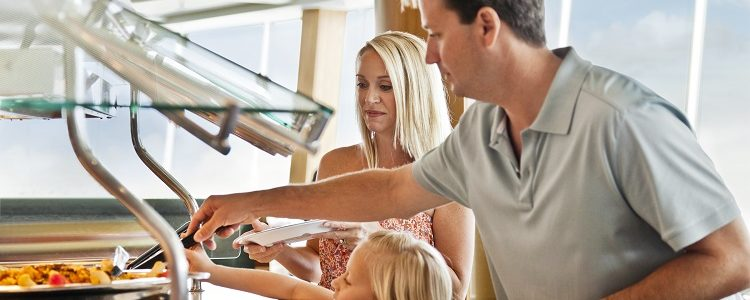 Family choosing food from a buffet on-board a Royal Caribbean cruise ship
