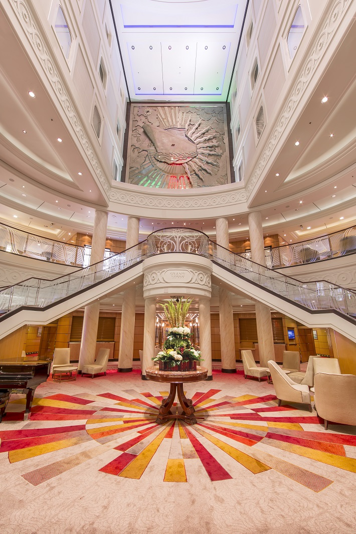 The grand, colourful Atrium on-board Cunard's Queen Mary 2 cruise ship