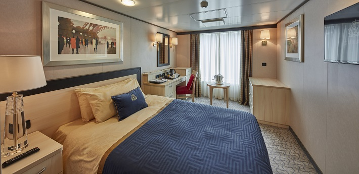 Elegant interior of an Ocean View stateroom on-board Cunard's Queen Victoria cruise ship