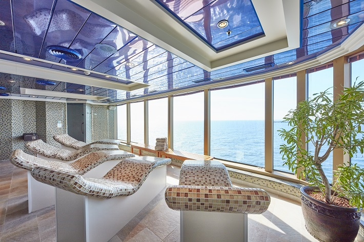 Luxurious mosaic loungers in front of floor to ceiling windows in Queen Victoria's spa