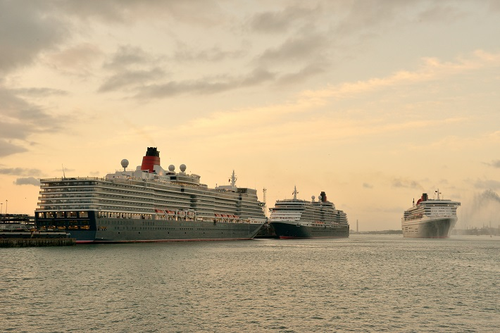 Cunard's Three Queens event in Southampton at sunset