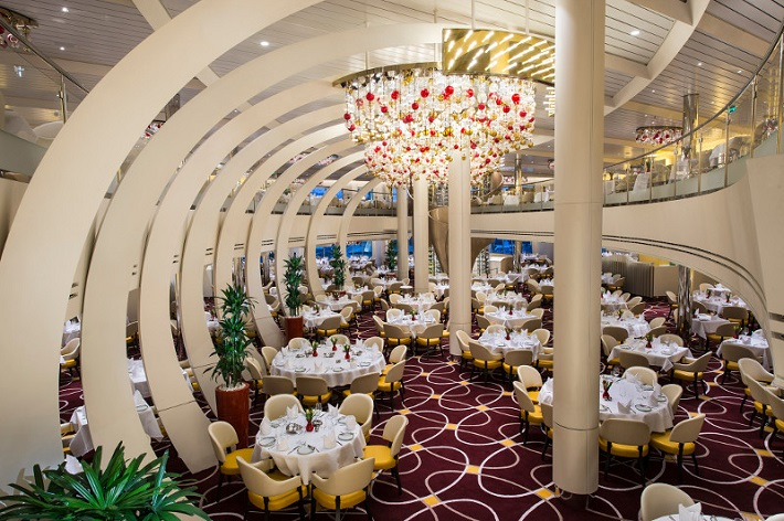 The elaborate main dining room on-board Holland America Line's Koningsdam