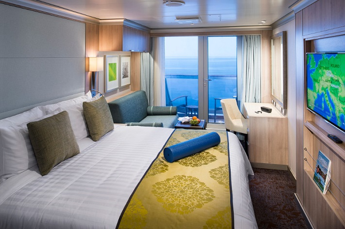 Elegant white and gold Verandah stateroom on-board HAL Koningsdam