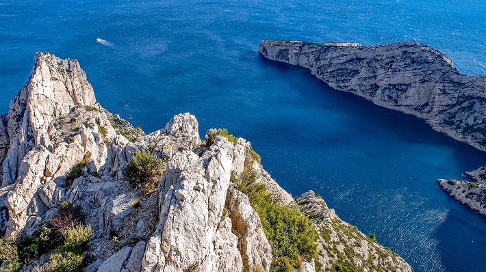 Bright blue seas and craggy cliffs on the coast of Marseille cruise port