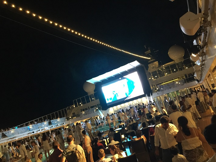 Guests gathered around the pool on-board MSC Meraviglia for the White Party