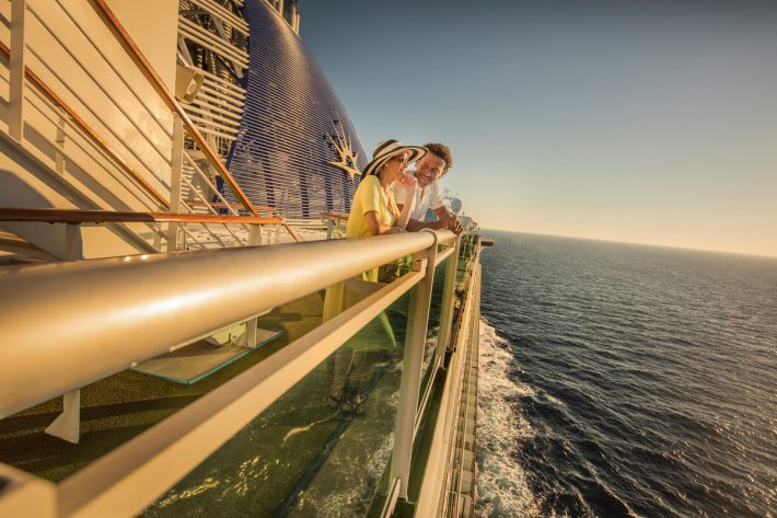 A couple admiring the view from the deck of a P&O Cruises ship
