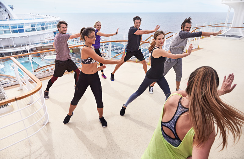 Guests taking part in a fitness class on-deck on a Princess cruise