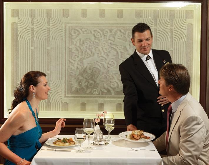 A couple dining in the Britannia Club restaurant on-board Cunard's Queen Elizabeth cruise ship